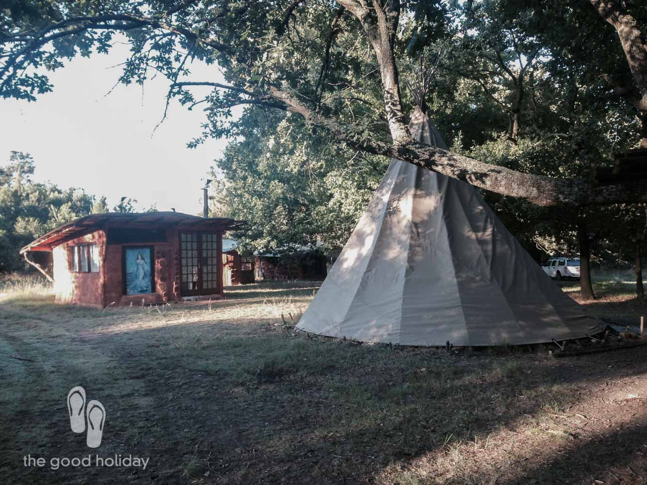 A Tipi Tent and a Hobbit House.
